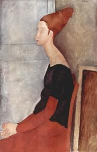 """Amedeo Modigliani, """"Jeanne Hébuterne seduta di profilo con vestito rosso"""", 1918, collezione privata."""